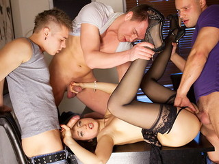 Lascivious underware doll in black stockings Taissia receives shot on hardcore porno clip when screwed by 3 chaps
